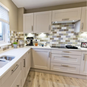 Stunning high quality made kitchen with a beautiful wood floor and a high class finish