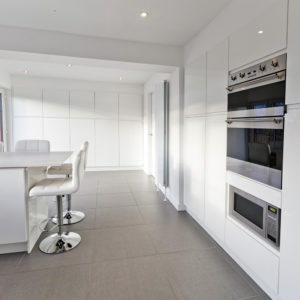Beautiful custom made kitchen with lots of cupboard space. Built and designed in Scotland