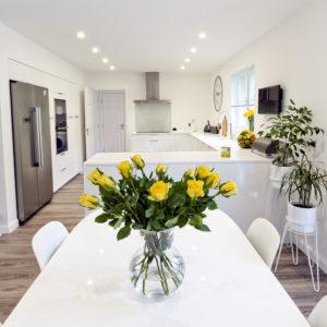 High quality custom designed white gloss kitchen
